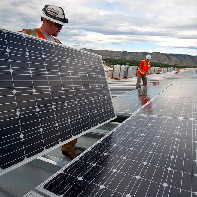 2 men installing solar panels